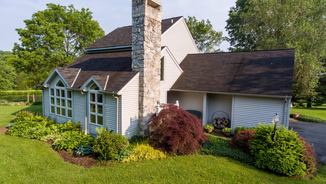 beautiful home with stone chimney and large backyard for sale in pa