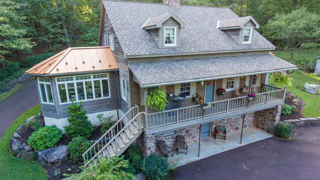 residential real estate listing with second story balcony and sunroom for sale in pa