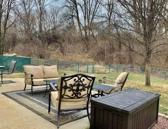 backyard furniture and lawn of new home for sale in wilson school district