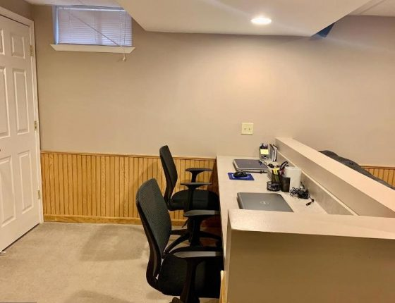 office chairs and built in desk in basement of new home sale