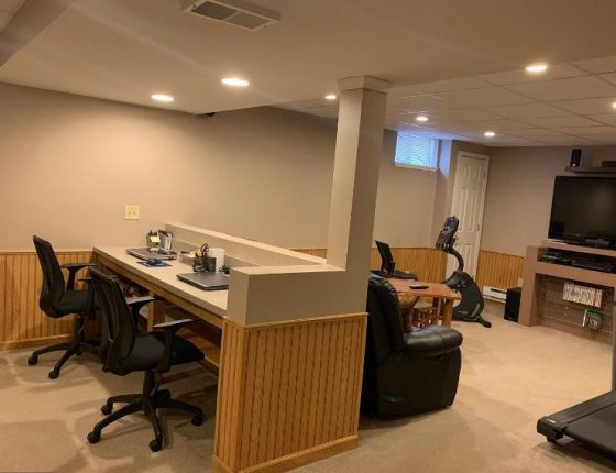office chairs and laptops computers in new home for sale basement