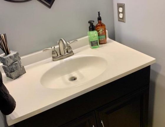 modern bathroom sink and cabinetry in new home for sale
