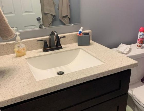 modern bathroom sink and accessories in new home for sale