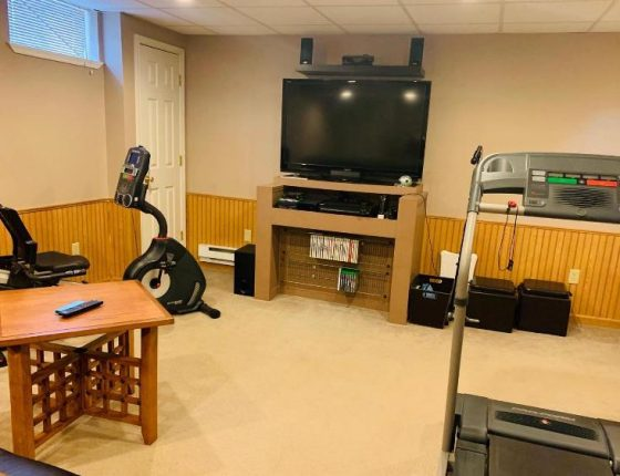 basement television and exercise equipment in new home for sale basement