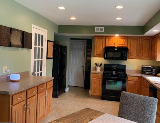 kitchen with green walls and white doors in new home sale