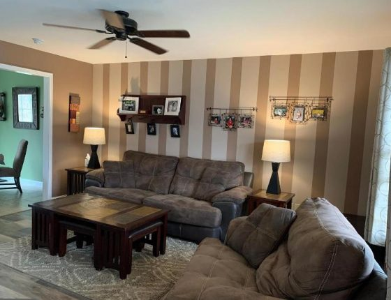 living room furniture and amenities in new home for sale in wilson school district
